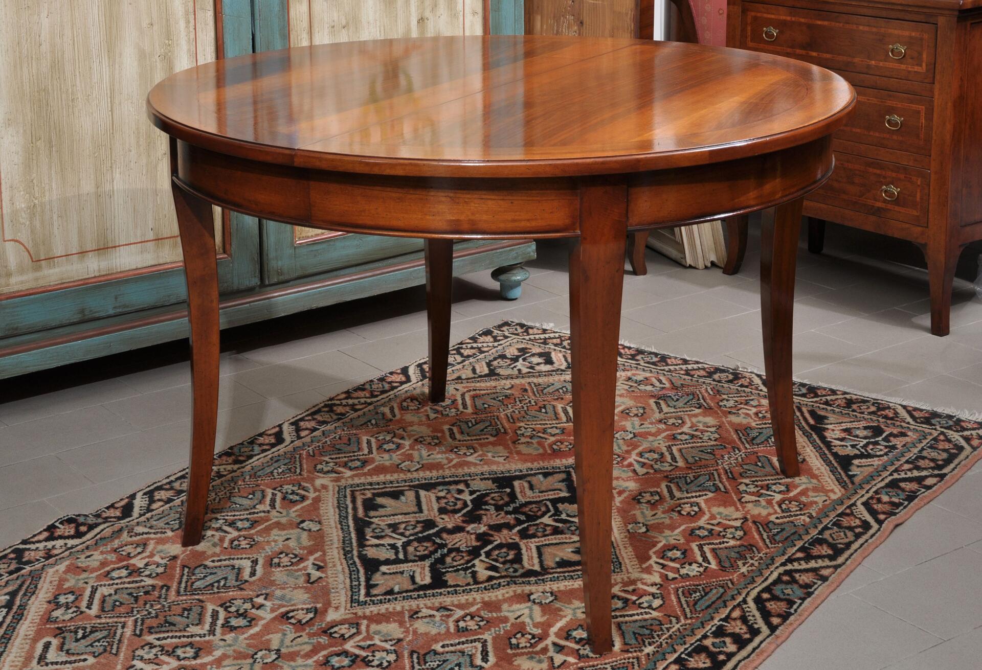 Tavolo rotondo allungabile realizzabile su misura in legno pregiato di noce con le gambe a ...